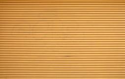 För rullslutare för beiga bruna horisontalrullgardiner Arkivfoto