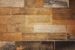 för sandstensten för abstrakt bakgrund röd vägg för textur Arkivbilder