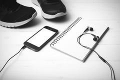 För signalfärg för rinnande skor, för anteckningsbok och för telefon svartvit styl Arkivbild