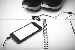 För signalfärg för rinnande skor, för anteckningsbok och för telefon svartvit styl Arkivbilder