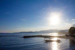 För solnedgång i Candidasa Bali Arkivfoto