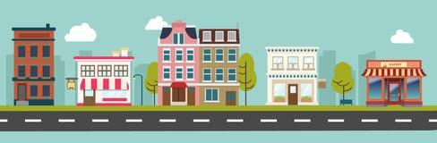 För stad vektor för byggnader för huvudsaklig gata och lager Arkivbild