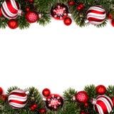 För struntsakdubblett för röd och vit jul gräns på vit arkivfoto