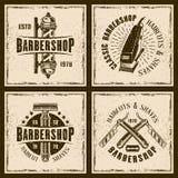 För tappninggrunge för frisersalong fyra kulöra emblem Royaltyfri Illustrationer