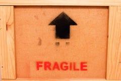 För teckensvart för Wood ask bräcklig röd pil Arkivbilder