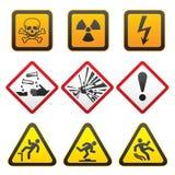 för teckensymboler för första fara set varna Arkivfoto