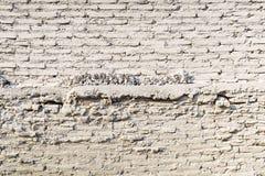 För tegelstenvägg för gammal tappning vit bakgrund för textur Arkivbild