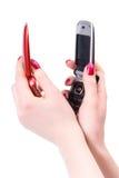 för telefonred två för svarta händer mobil kvinna Arkivfoto