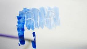 För textinskrift för reva bläckar allvarliga målarfärger ner för konstnär för vattenfärg isolerat på vit bakgrund lager videofilmer