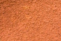För texturmålarfärg för betongvägg orange bakgrund Royaltyfri Fotografi