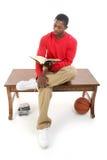 för tillfällig sittande tabell manavläsning för bok Arkivbild