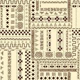 För traditionellt etniskt afrikanskt sömlös modell mudclothtyg för beiga och för brunt, vektor Royaltyfri Foto