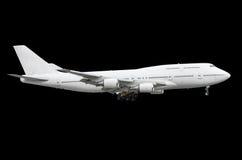 För två-våningen för den stora passageraren isolerade det isolerade vita flygplanet flygplan svart bakgrund Arkivfoto