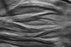 För tygtextur för skrynkla svart bakgrund för abstrakt begrepp för produkt- eller textbakgrunddesign Arkivfoto