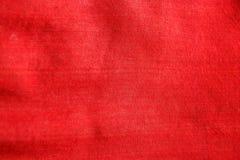 För tygtorkduk för närbild röd traditionell textur, textildetaljbakgrund royaltyfri fotografi