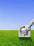 för uttagpropp för energi grön stickkontakt för ström Arkivfoton