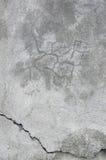 För väggstuckaturen för Grunge texturerade grå textur, naturlig grå lantlig konkret murbrukmakrocloseup, den knäckte gamla åldrig Arkivfoto