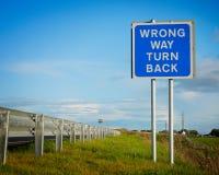 för vägmärke wrong långt Fotografering för Bildbyråer