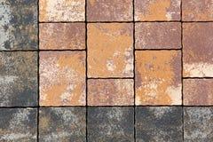 Förberedande kvarter för trottoar i olika färger och format royaltyfri bild
