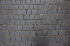 Förberedande stenar på den gamla staden i Europa Textur slut upp Arkivbild