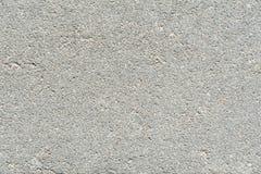 Förberedande tjock skiva, textur av strukturen av den konkreta yttersidan med bråkdelar av små stenar Arkivbilder