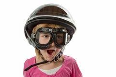 Förberett - flicka med hjälmen och skyddsglasögon Arkivbild