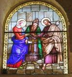 Förbindelse av St Joseph och Mary, målat glassfönster av Chuen Royaltyfri Foto
