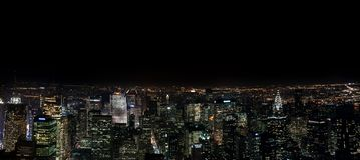 Förbluffa sikt för panorama- natt för NYC flyg- Manhattan område USA royaltyfri fotografi