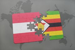 förbrylla med nationsflaggan av Österrike och Zimbabwe på en världskartabakgrund Royaltyfri Foto
