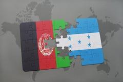 förbrylla med nationsflaggan av Afghanistan och Honduras på en världskartabakgrund Royaltyfri Bild