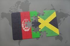 förbrylla med nationsflaggan av Afghanistan och Jamaica på en världskartabakgrund Royaltyfria Bilder