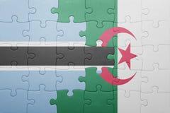 förbrylla med nationsflaggan av Algeriet och Botswana Arkivbild