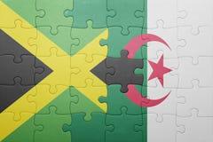 förbrylla med nationsflaggan av Algeriet och Jamaica Arkivbilder