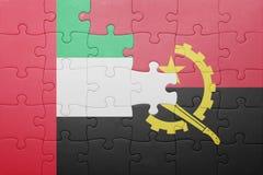 förbrylla med nationsflaggan av Angola och Förenade Arabemiraten Royaltyfri Bild