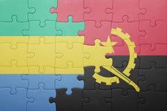 förbrylla med nationsflaggan av Angola och Gabon Royaltyfri Fotografi