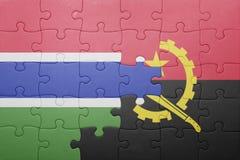 förbrylla med nationsflaggan av Angola och Gambia Arkivfoto