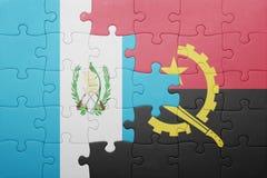 förbrylla med nationsflaggan av Angola och Guatemala Royaltyfri Bild