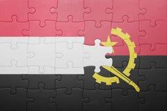 förbrylla med nationsflaggan av Angola och Jemen Royaltyfri Foto