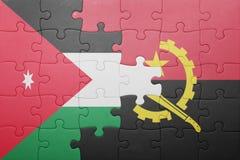 förbrylla med nationsflaggan av Angola och Jordanien Arkivfoton