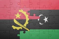 förbrylla med nationsflaggan av Angola och Libyen Royaltyfria Foton