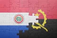 förbrylla med nationsflaggan av Angola och Paraguay Royaltyfria Foton
