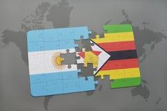 förbrylla med nationsflaggan av Argentina och Zimbabwe på en världskarta Royaltyfri Fotografi