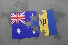 förbrylla med nationsflaggan av Australien och Barbados på en världskartabakgrund Royaltyfri Fotografi