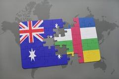 förbrylla med nationsflaggan av Australien och Centralafrikanska republiken på en världskartabakgrund Royaltyfri Fotografi