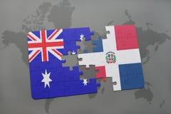 förbrylla med nationsflaggan av Australien och Dominikanska republiken på en världskartabakgrund Royaltyfria Bilder