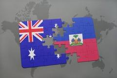 förbrylla med nationsflaggan av Australien och Haiti på en världskartabakgrund Royaltyfri Fotografi