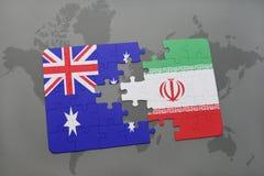 förbrylla med nationsflaggan av Australien och Iran på en världskartabakgrund Royaltyfria Bilder