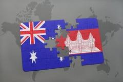 förbrylla med nationsflaggan av Australien och Kambodja på en världskartabakgrund Arkivbild