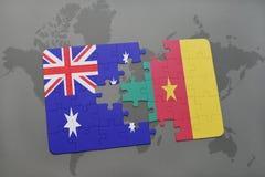 förbrylla med nationsflaggan av Australien och Kamerun på en världskartabakgrund Royaltyfri Foto