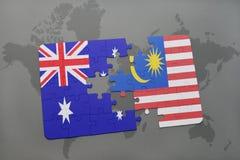förbrylla med nationsflaggan av Australien och Malaysia på en världskartabakgrund Royaltyfria Foton